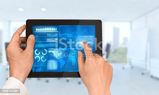 istock Hands holding tablet with financial data inside office 538144361