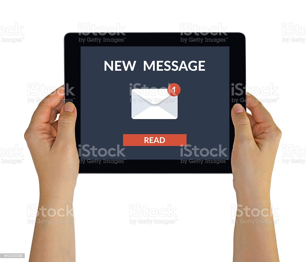 Hands holding tablet with new message concept on screen stock photo