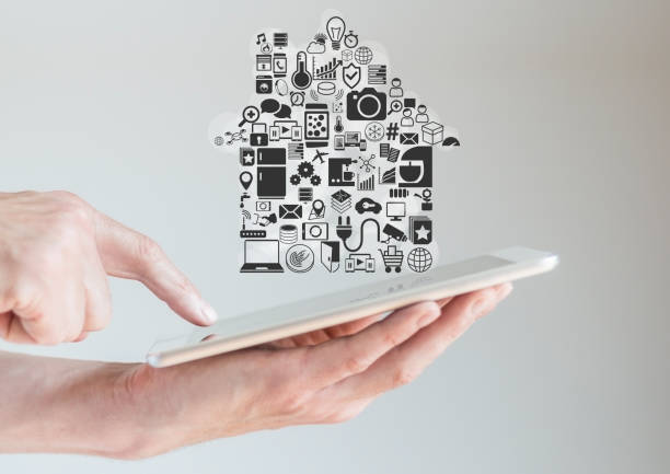 Hands holding tablet with smart home automation concept stock photo