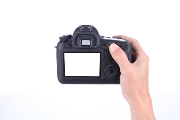 Hands holding the dslr camera on white background picture id1091204880?b=1&k=6&m=1091204880&s=612x612&w=0&h= lqlrugqsg6vslafdet7pijlih7td526njdpvt4xupg=