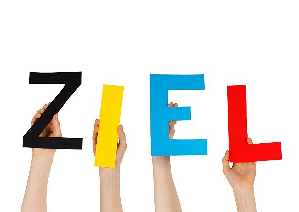 hands holding the german word ZIEL some hands hold the german word ZIEL, isolated ziel stock pictures, royalty-free photos & images