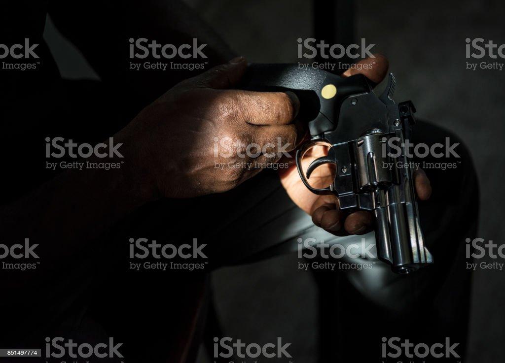 Hands holding the gun stock photo
