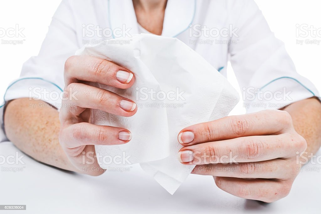 Hands holding tissue stock photo