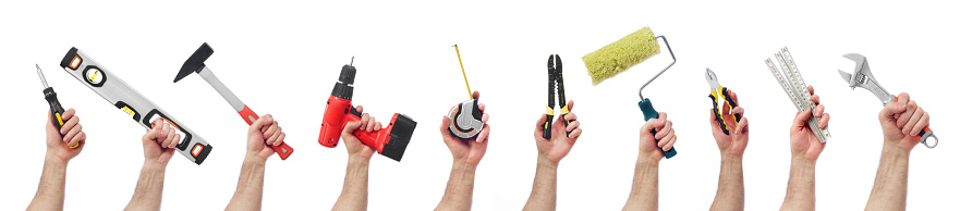 Hands raised holding different tools