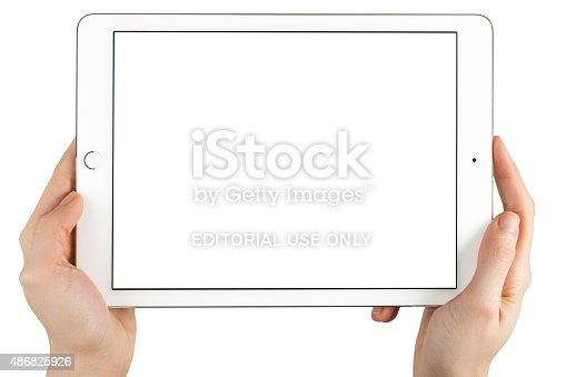 istock Hands Holding Touch Screen Apple iPad Air2 486825926
