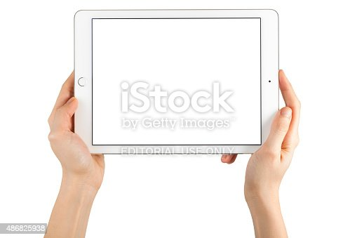 istock Hands Holding Touch Screen Apple iPad Air2 486825938