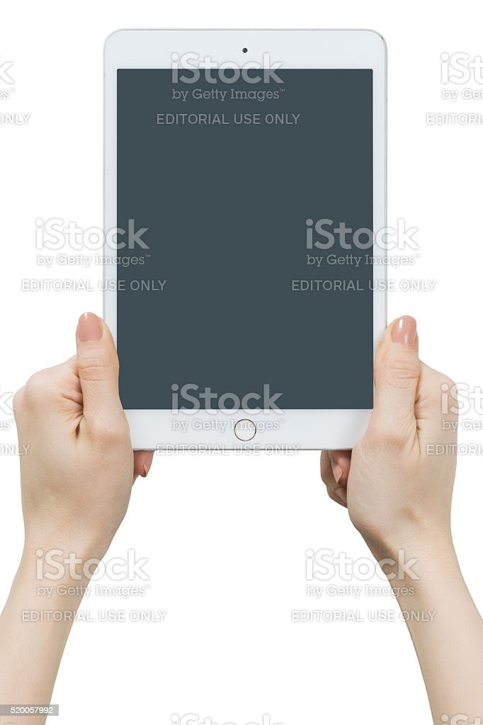 Hands Holding Touch Screen Apple iPad Mini4 stock photo