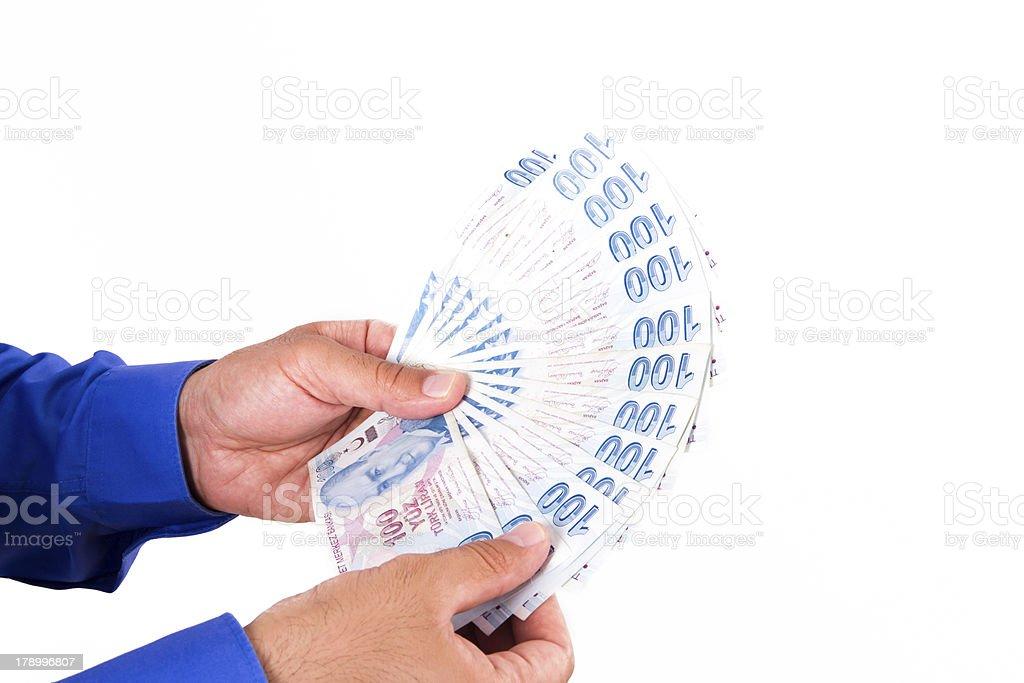 Hands Holding Turkish Lira Banknotes royalty-free stock photo