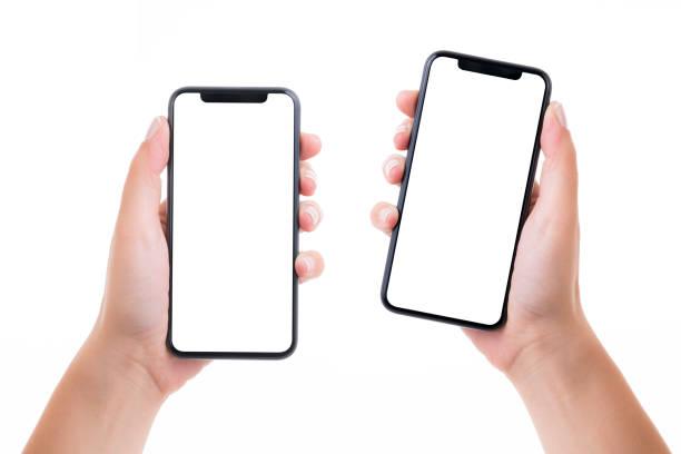 mani che tengono due smartphone a schermo bianco bianco - smart phone foto e immagini stock