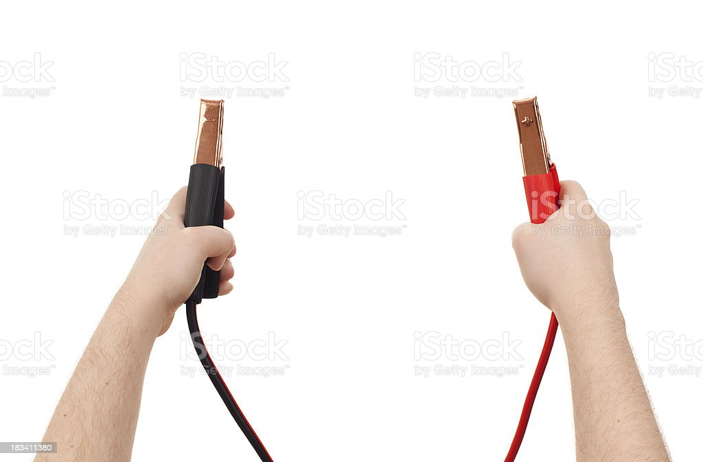 Hands holding up Jumper Cables stock photo