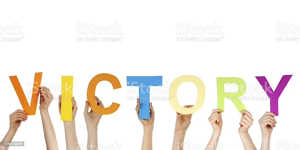 hands holding victory stock photo