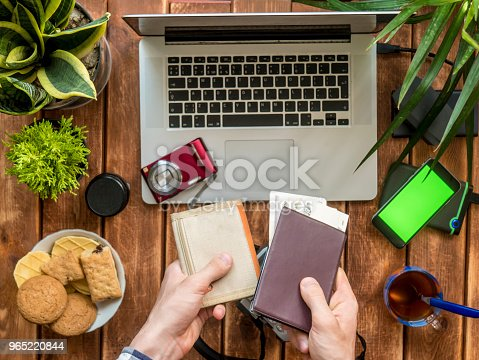 Hands Holding Wallet Passport And Cash Over Wooden Work Place Stock Photo & More Pictures of Adult