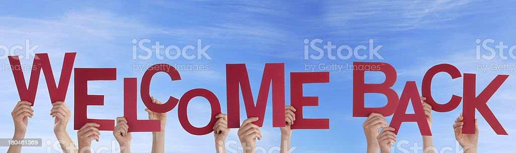 Hands Holding Welcome Back in the Sky stock photo