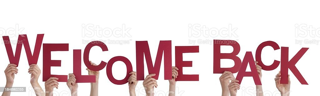 Hands Holding Welcome Back royalty-free stock photo