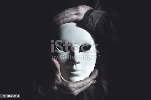 istock hands holding white mask 861868424
