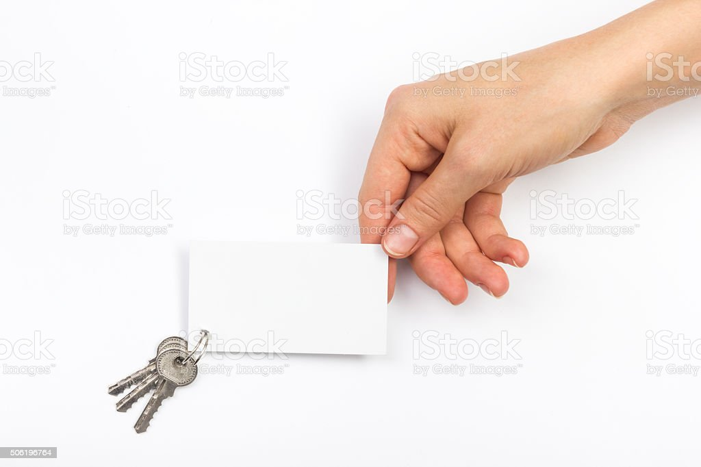 Hands holdingblank business card on white background. Real Estate. stock photo