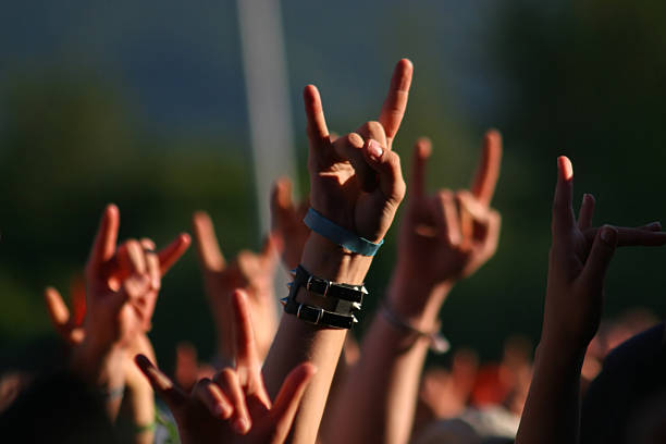 Hands in air at concert making rock sign gesture Fans fan club stock pictures, royalty-free photos & images