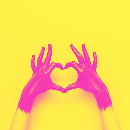 istock hands in black paint send heart 927775556