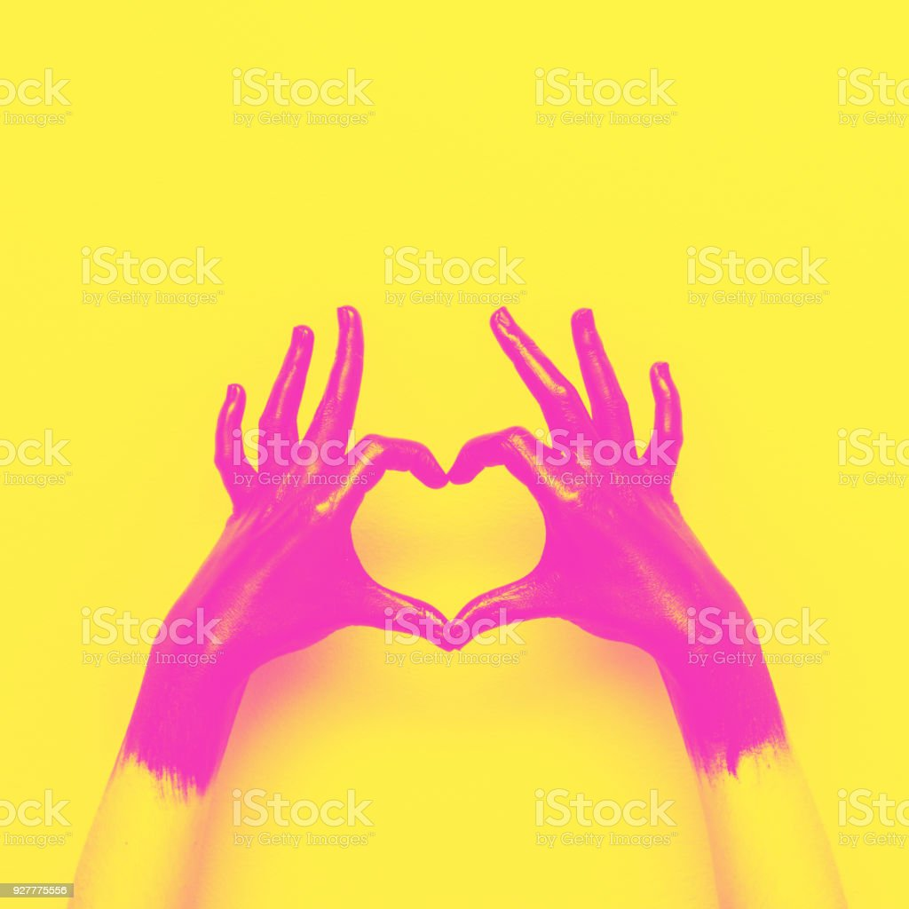 hands in black paint send heart stock photo