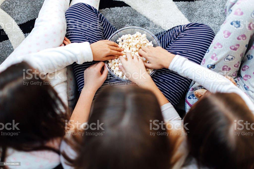 Hands In Bowl Full Of Popcorn stock photo