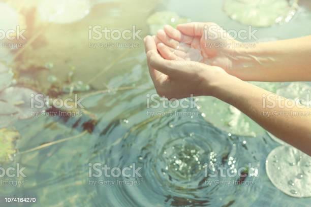 Hands in cupped form getting water from a lake or fountain picture id1074164270?b=1&k=6&m=1074164270&s=612x612&h=bzxjxj eyh6ptsdfnpt47a174veta sxbxr09u2qox4=
