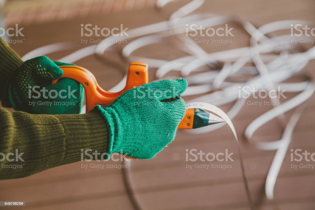 hands in gloves twist the geodetic roulette stock photo