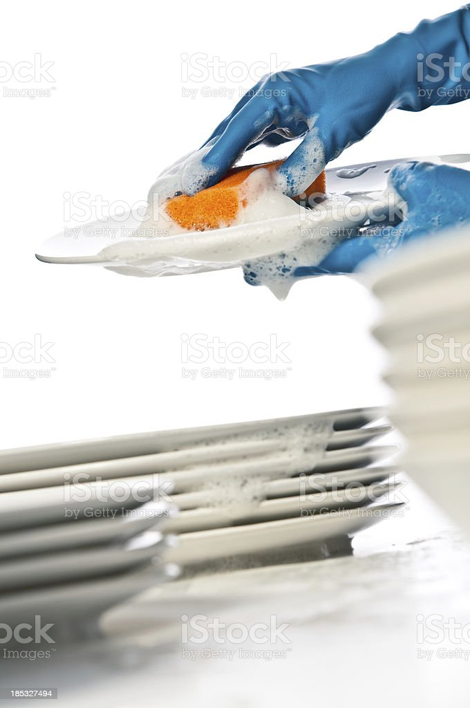 Hands in gloves washing dishes royalty-free stock photo