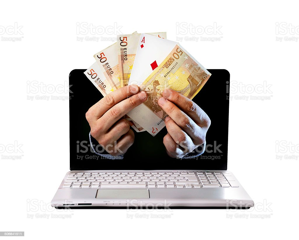hands in laptop with banknotes and ace poker playing card stock photo