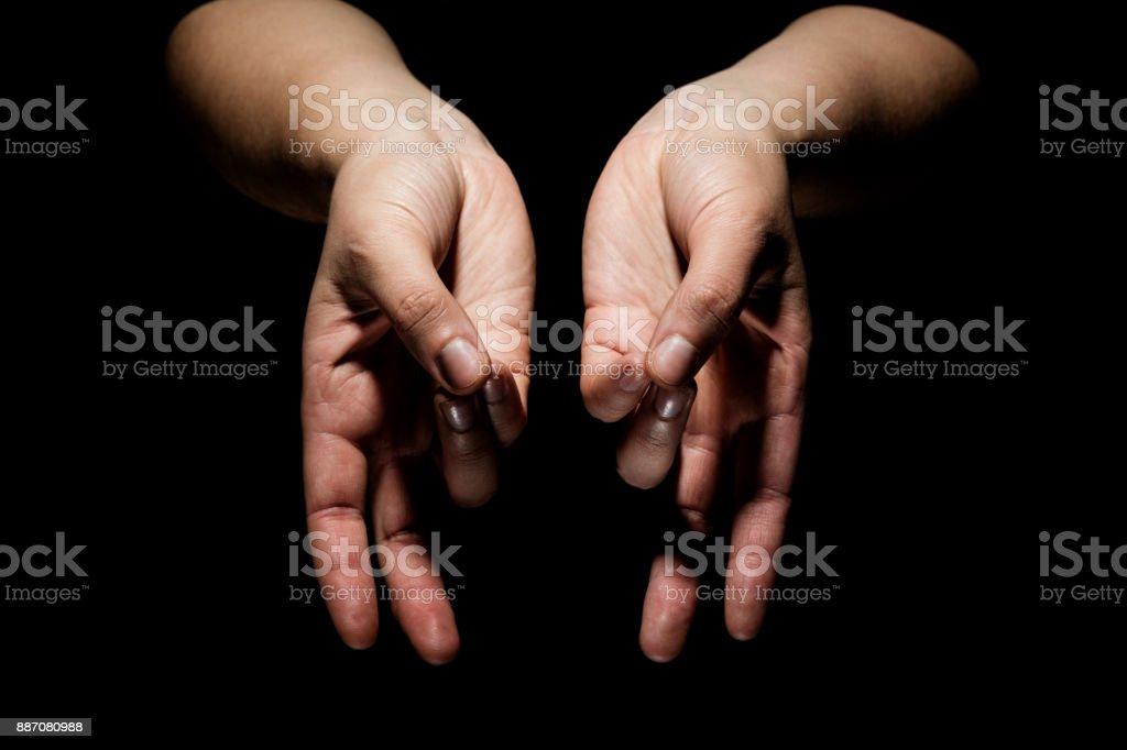 hands in mudra hands in mudra gesture on black background Active Lifestyle Stock Photo