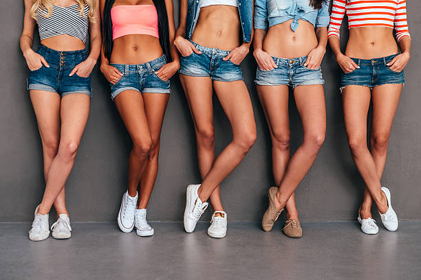 hands in pockets. - jean shorts stock photos and pictures