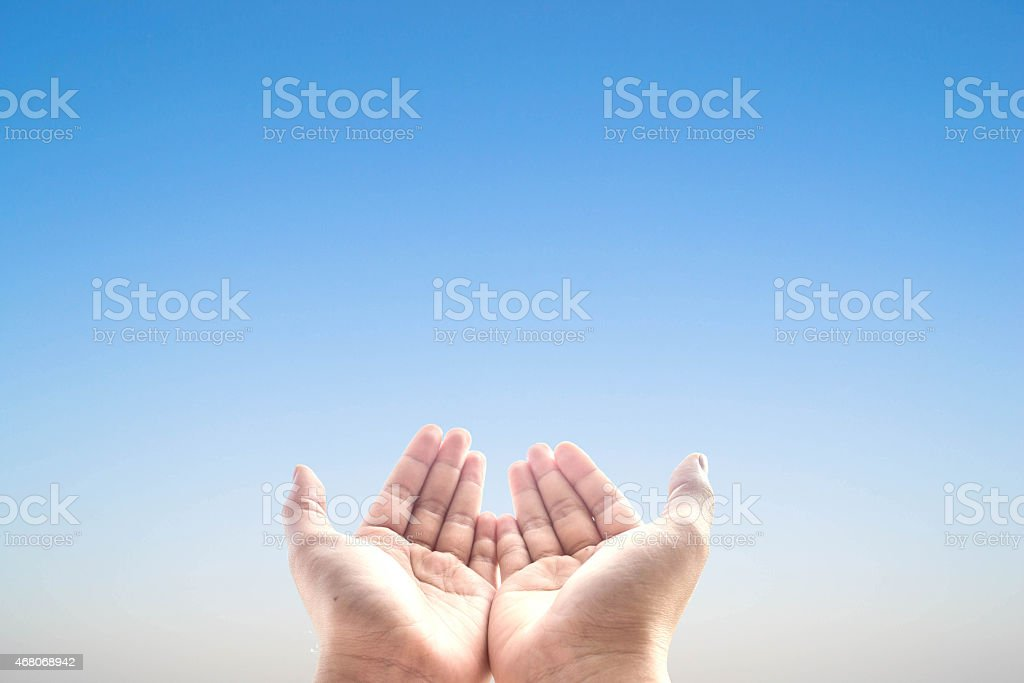 Hands in position to receive in blue background stock photo