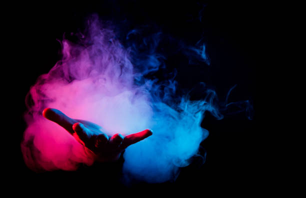 hands in smoke on black background stock photo