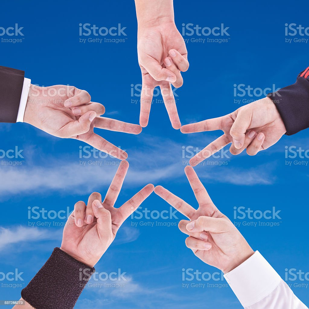 Hands in the form of a star stock photo