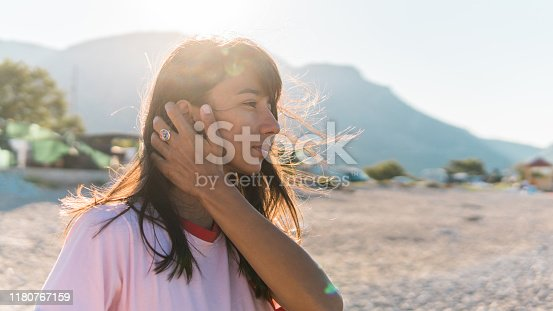 Hands in wavy hair by the beach