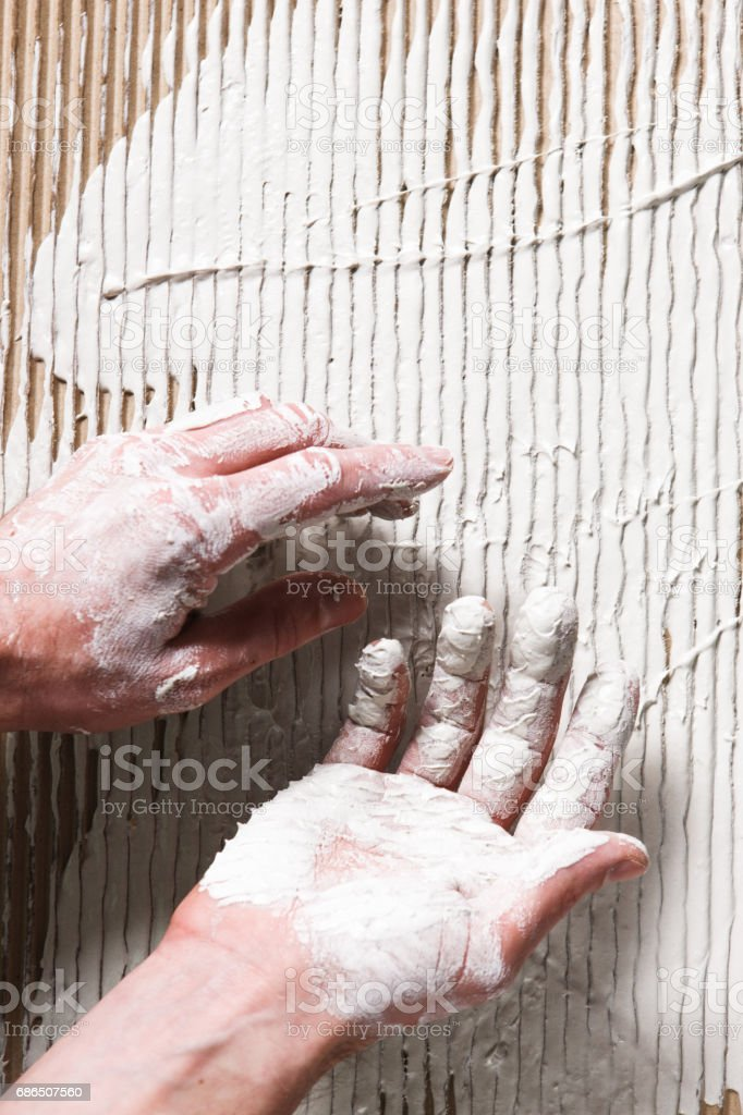 Hands in white plaster on stucco surface, flat lay foto stock royalty-free