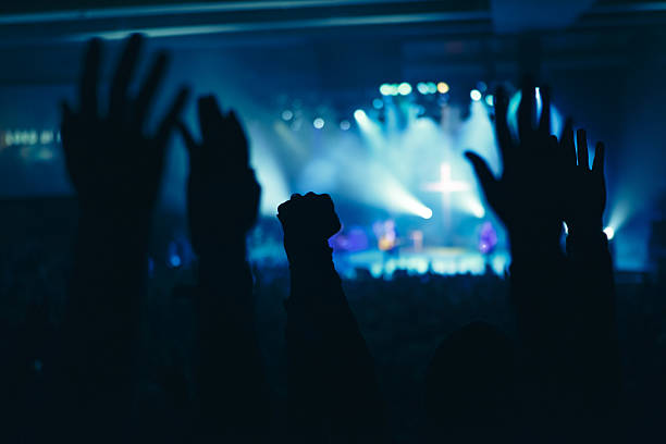 hands in worship - praise and worship stock photos and pictures