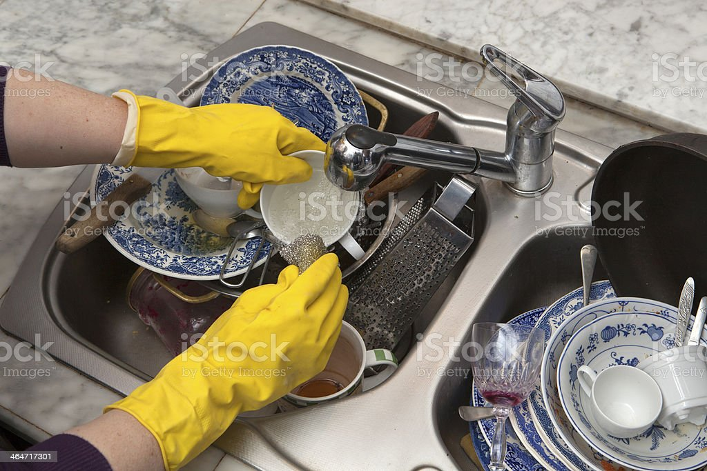 Hands in yellow gloves stock photo