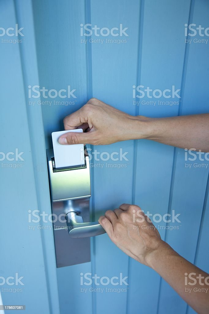 hands inserting keycard in electronic lock card open or close stock photo