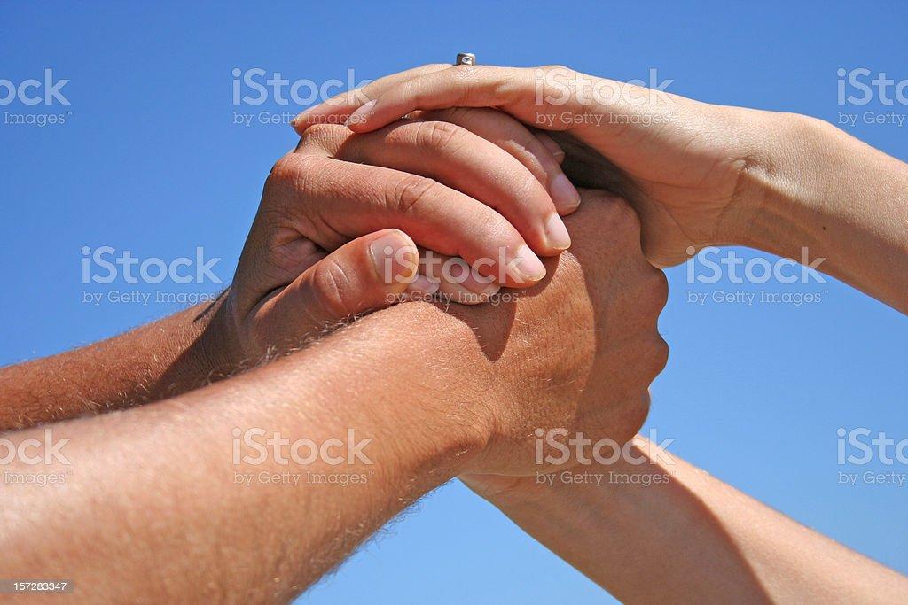 Hands interlocking in show of teamwork royalty-free stock photo