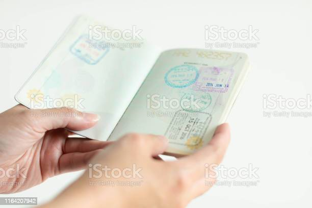 Hands is holding passport with immigration stamp inside picture id1164207942?b=1&k=6&m=1164207942&s=612x612&h=ey9cyinkis9npkqnheh6hvlfskkqp7d2izabr6 iwuk=