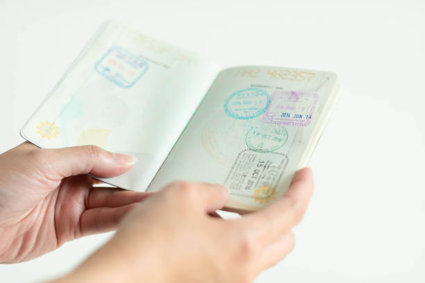 Hands is holding passport with immigration stamp inside picture id1164207942?b=1&k=6&m=1164207942&s=612x612&w=0&h=wfdmle ljo9trpk 7pwhq olbmgef6n4rqttgkwkino=