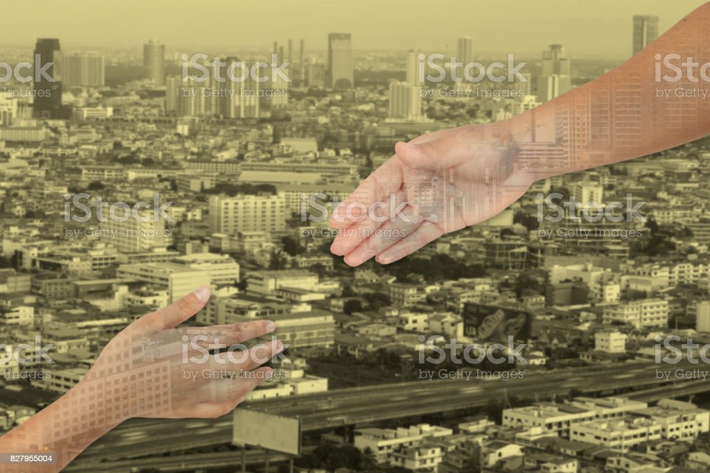Hands is part of body woman and kid  for helping with cityscape background and yellow tone. stock photo