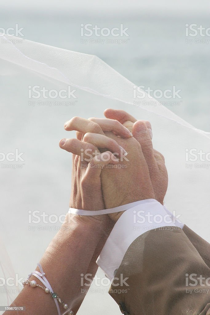 Hands joined in marriage stock photo