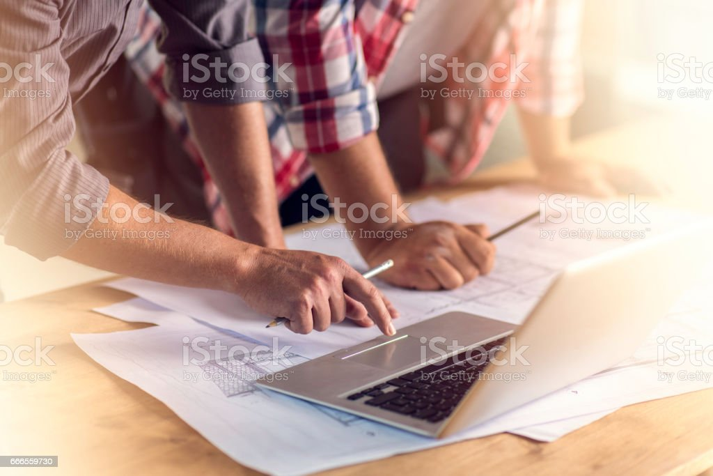 Hands, laptop and blueprints stock photo