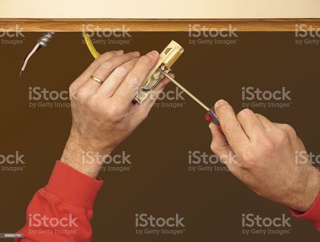 Hands making an electrical connection royalty-free stock photo