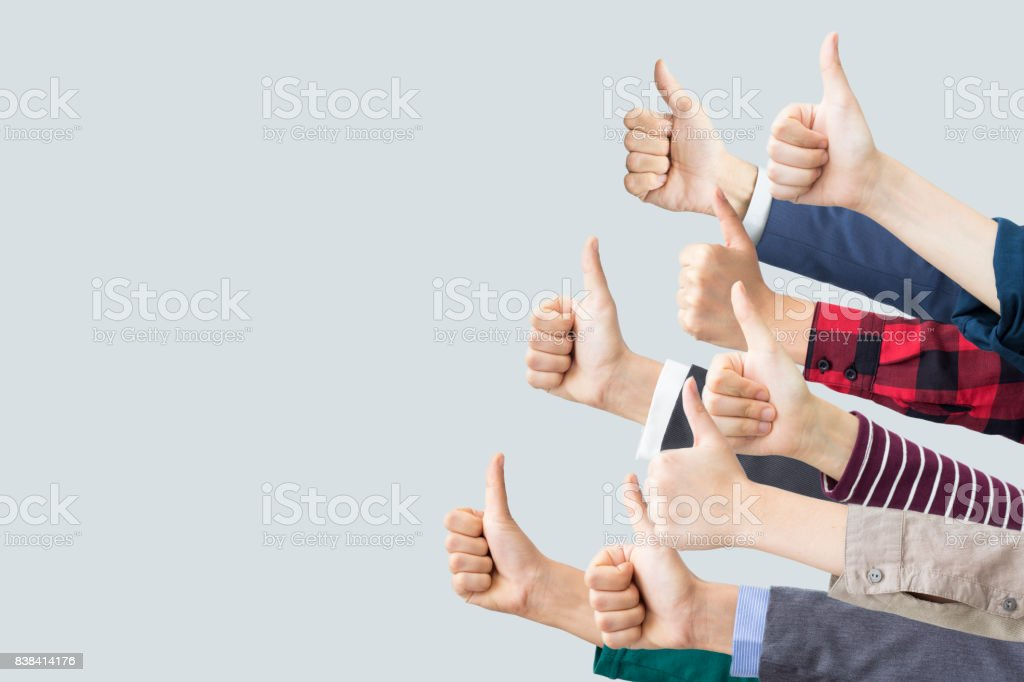 Hands making thumbs up stock photo