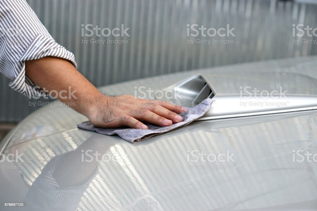 Hand's man cleaning car stock photo