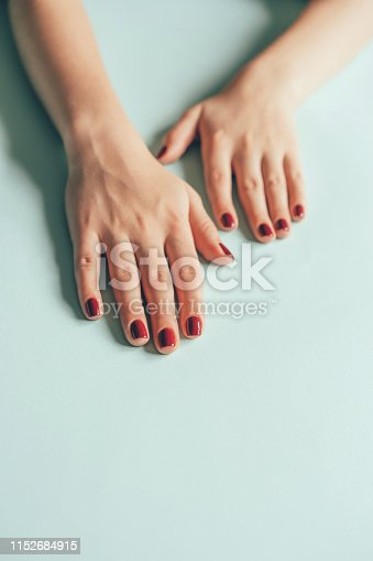 946930880istockphoto hands manicure red cherry 1152684915