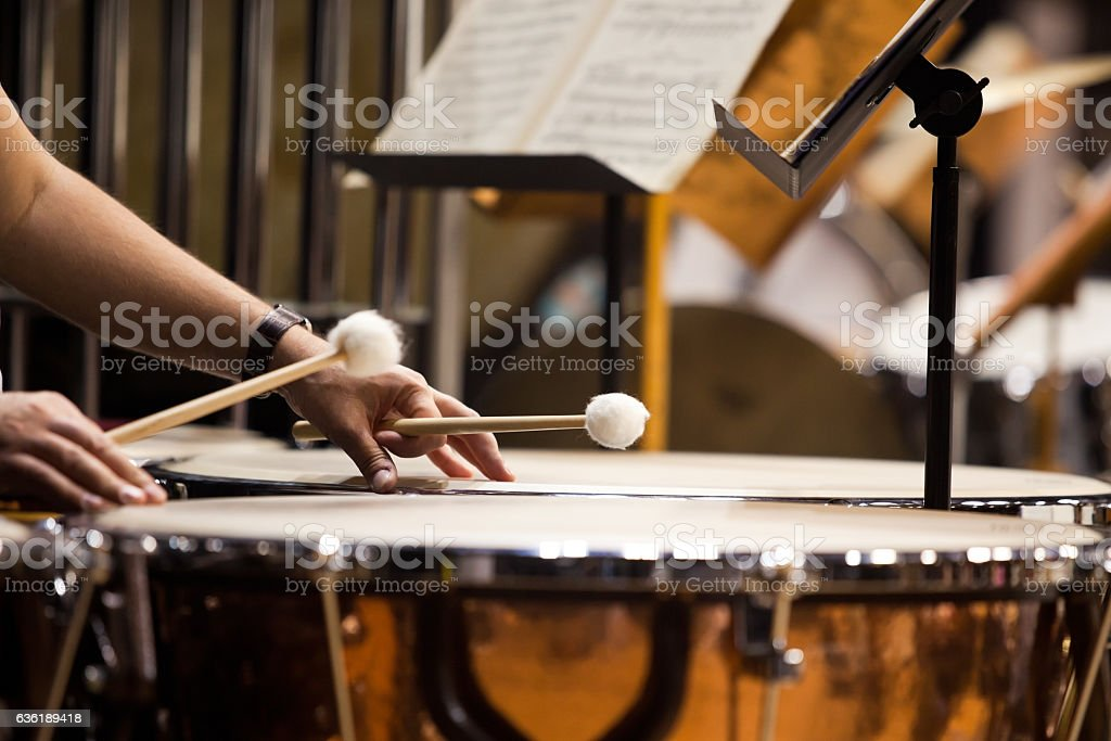 Hands musician playing the timpani stock photo