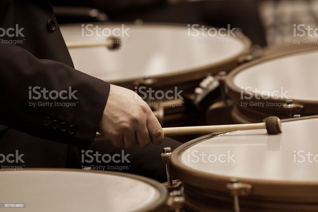 Hands musician playing timpani stock photo